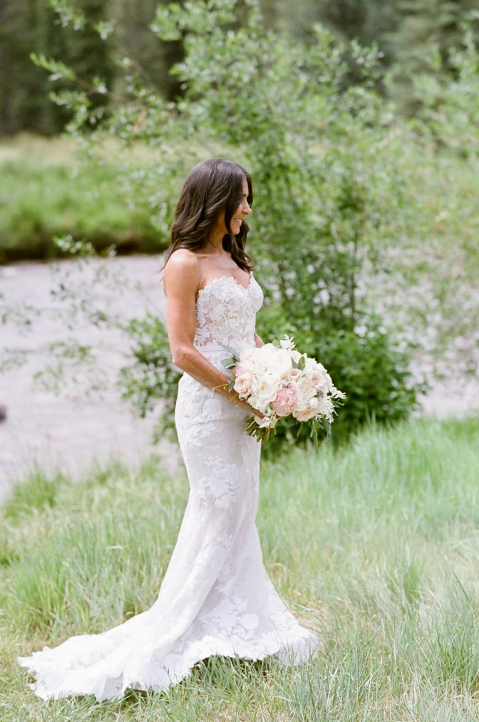 Portrait session of bride in front of creek in Vail Colorado