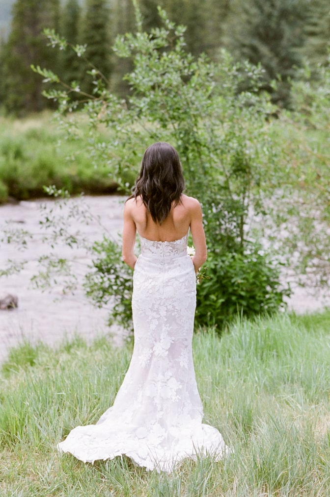 Back view of bride's Mira Zwillinger wedding dress in Vail
