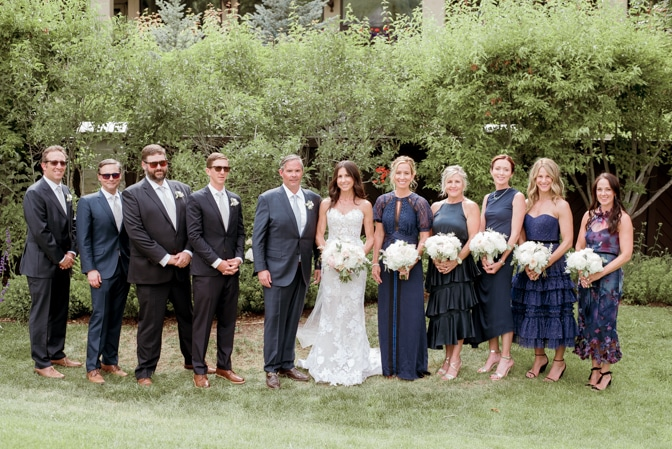 Bridal party together after ceremony on lawn at Larkspur Events and Dining in Vail