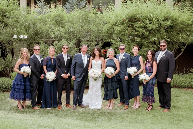 Bridal party together after ceremony on lawn at Larkspur Events and Dining in Vail in Colorado