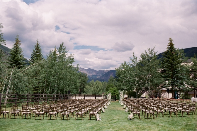 Large decoration of white flowers and greenery next to chairs at Larkspur Events and Dining in Vail Colorado