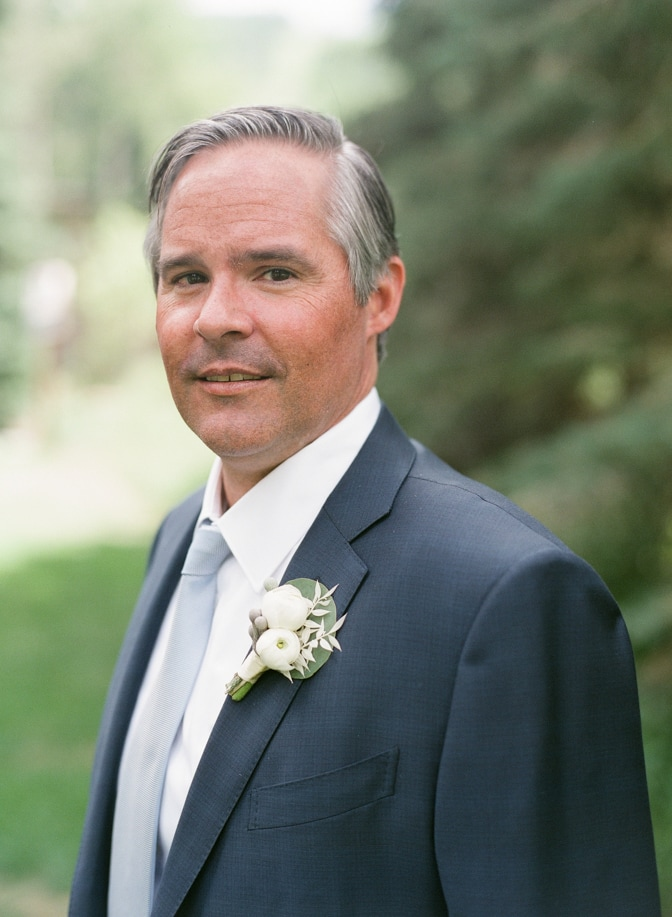 Groom in navy blue suit at Larkspur Events and Dining in Vail