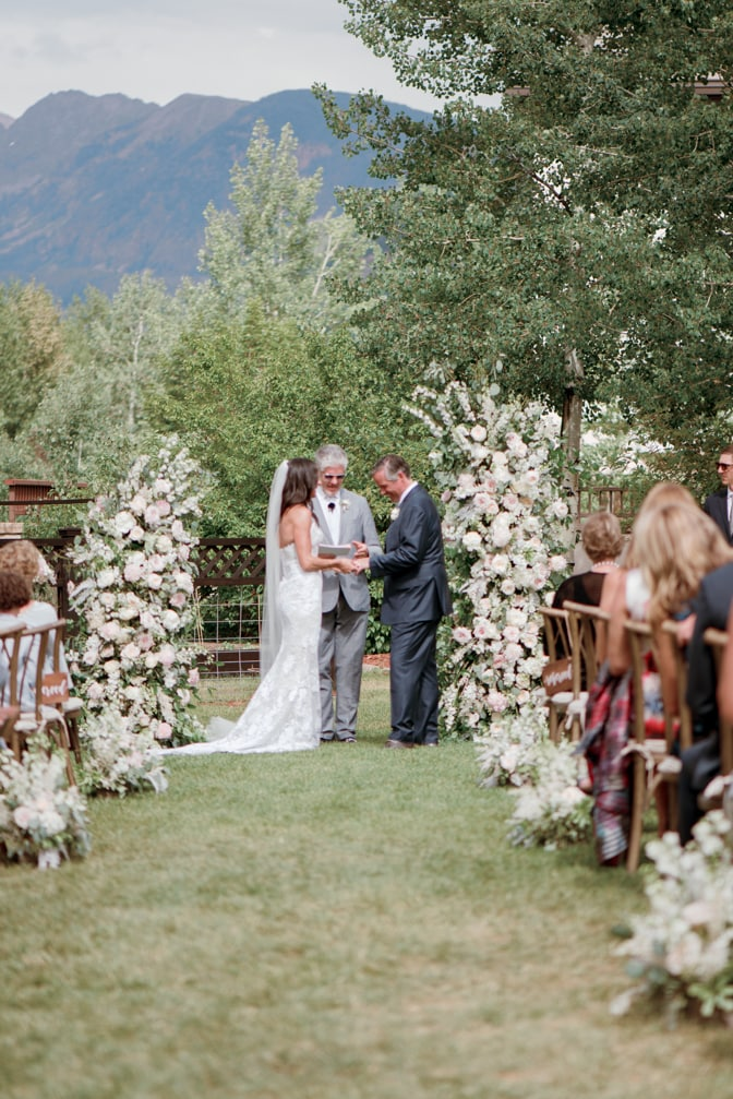 Exchanging of wedding rings at Larkspur Events and Dining in Vail