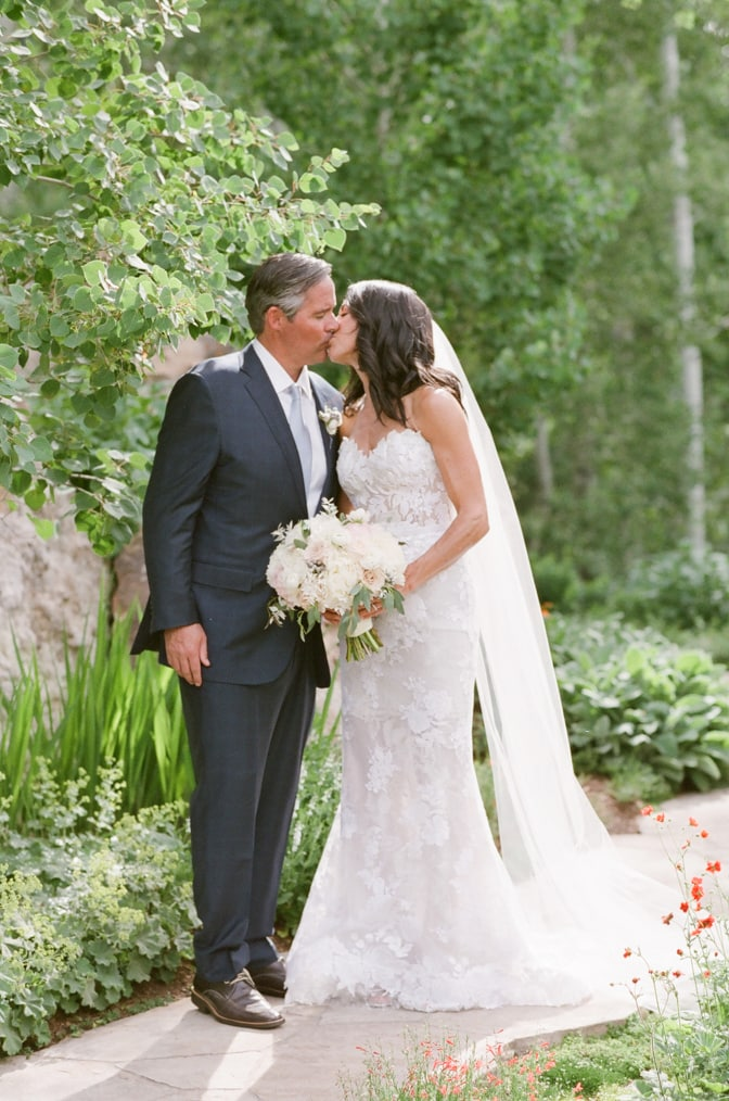 Romantic wedding session of couple kissing each other at Larkspur Events and Dining in Vail