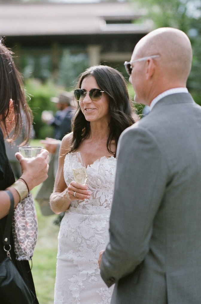 Wedding guests toasting with bride during cocktail hour at Larkspur Events and Dining in Vail