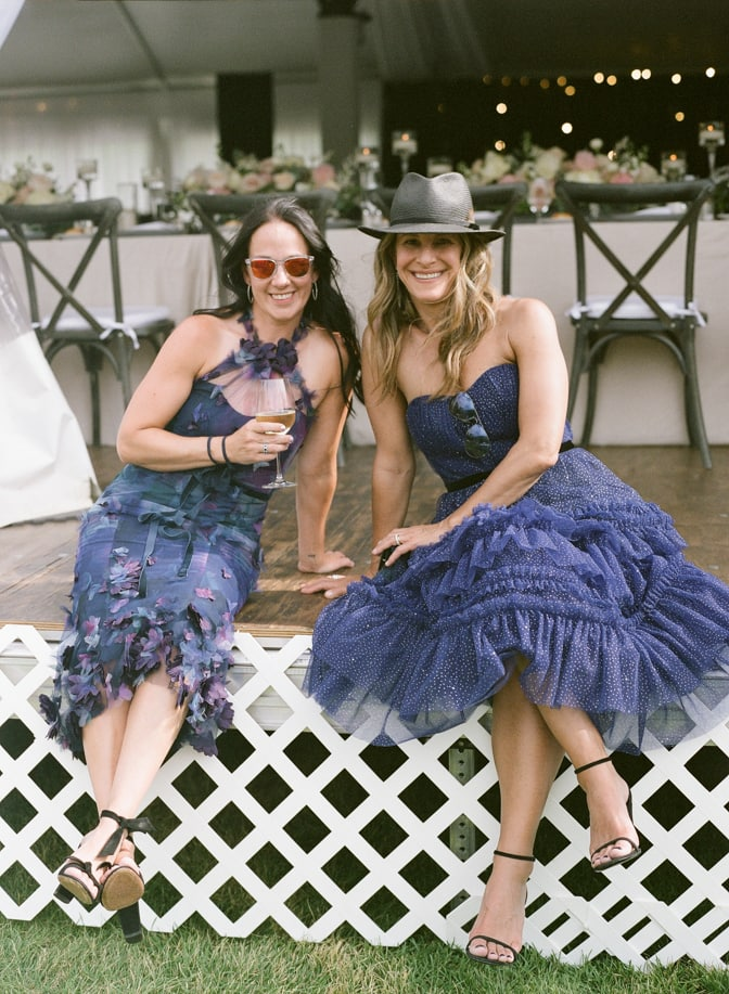 Bridesmaids in blue dresses toasting during cocktail hour at Larkspur Events and Dining in Vail