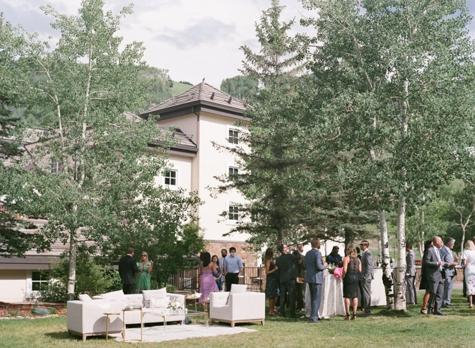 Wedding guests toasting during cocktail hour at Vail wedding