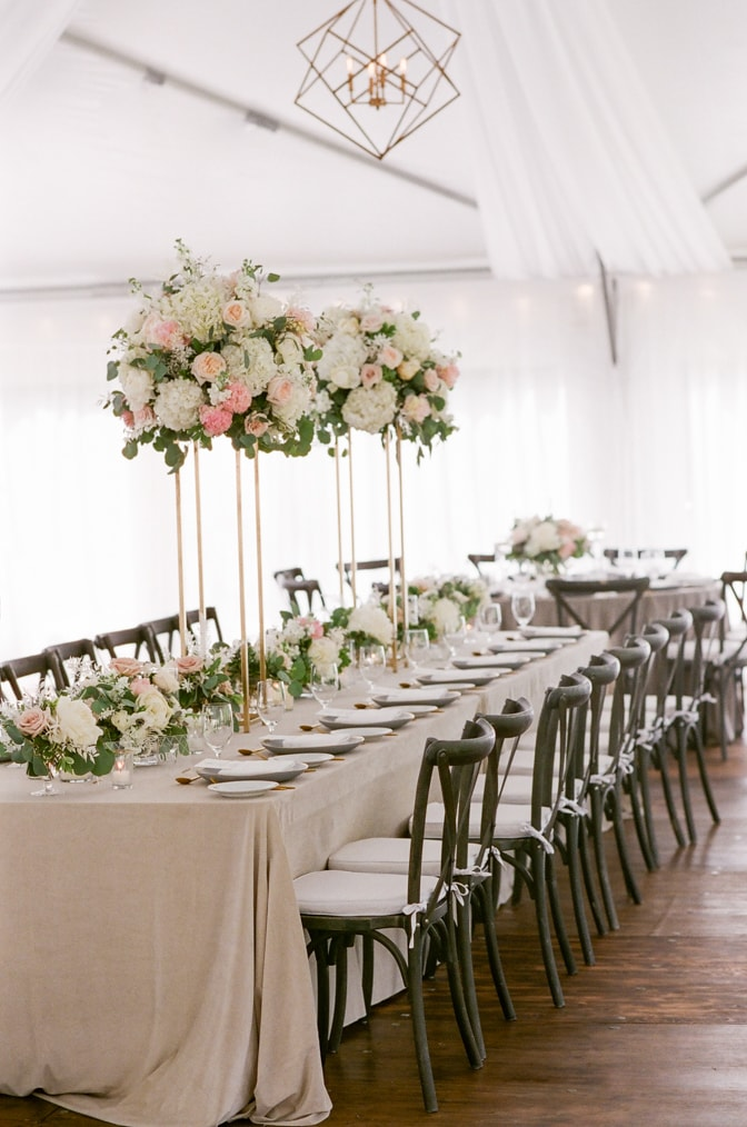 Variety of high and low arrangements accentuated with a rectangular table at Vail wedding