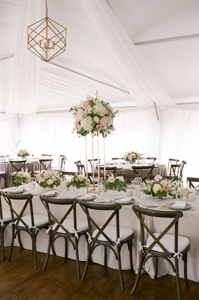 Variety of high and low blush arrangements accentuated with a rectangular table