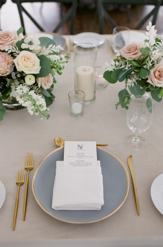 White menu with blue text on plate at Vail wedding reception