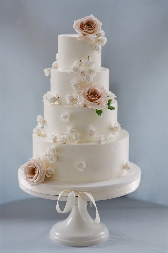 White cake accented with blush flowers during Vail wedding at Larkspur Events and Diniing