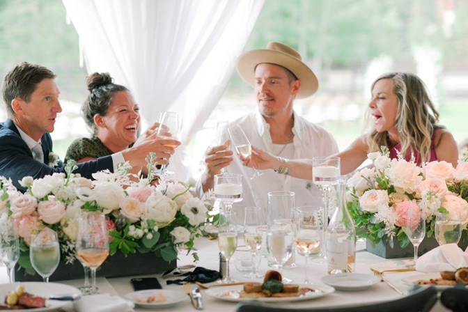 Guests toasting at Larkspur Events and Dining Vail wedding