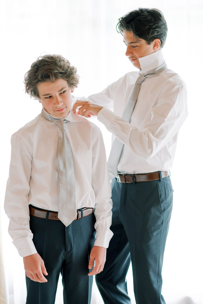 Two brothers in matching ring bearer outfit getting ready at Four Seasons in Vail Colorado