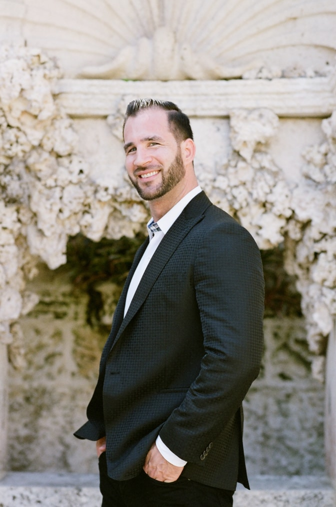 Portrait of groom in his classic black outfit at Vizcaya Museum and Gardens in Miami