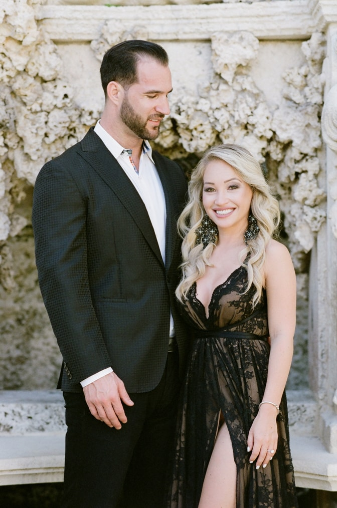 Bride and groom to be in their fashionable black outfits at the Vizcaya Museum and Gardens