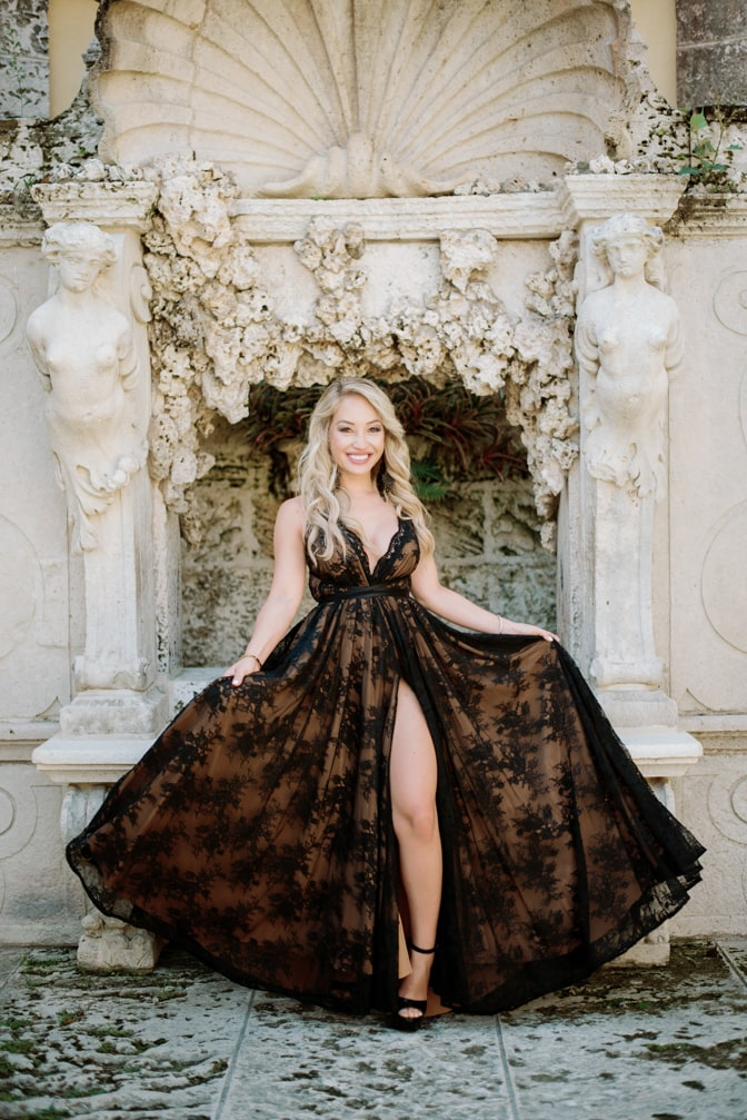 Bride to be twirling in her black lace dress at Vizcaya Museum and Gardens in Miami