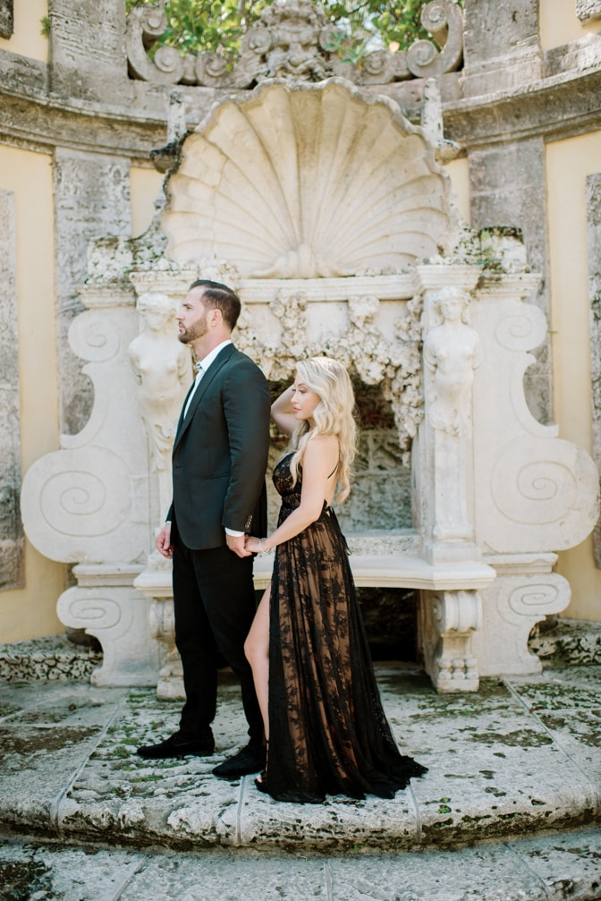 Engaged couple holding hands during their engagement session at Vizcaya Museum and Gardens