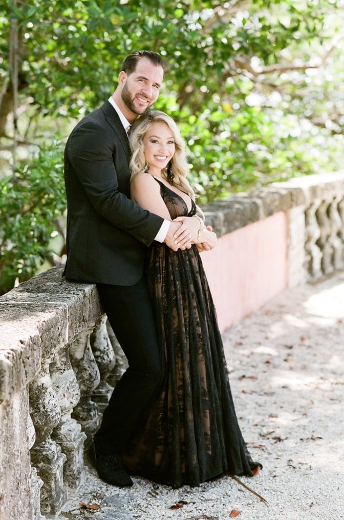 Bride and groom to be embracing each other in their fashionable outfits during their Miami engagement session