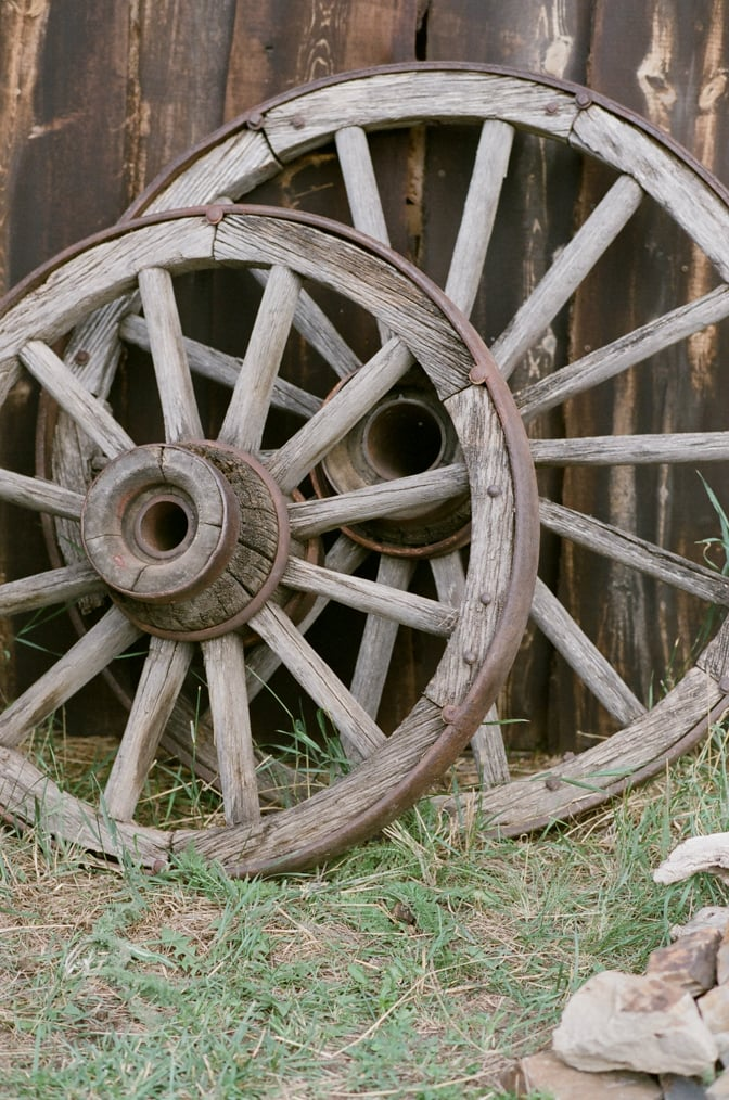 Closeup of wood wheels on a private ranch in Colorado Springs