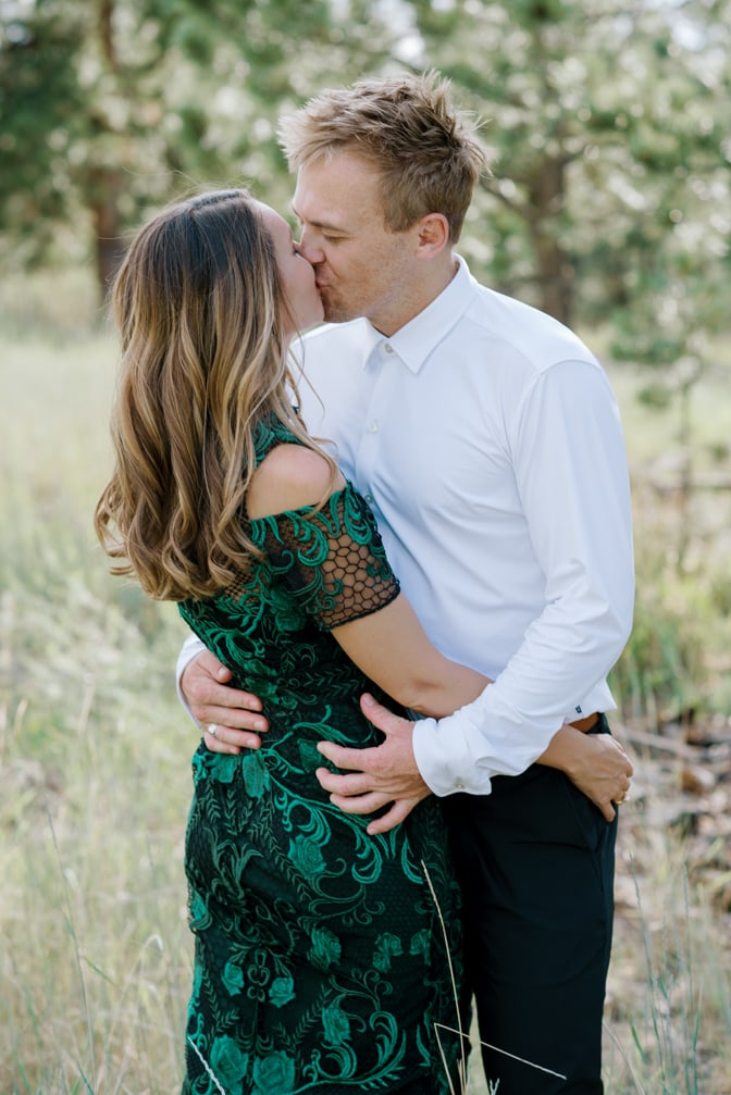 Engaged couple kissing during their Colorado engagement session in Colorado Springs