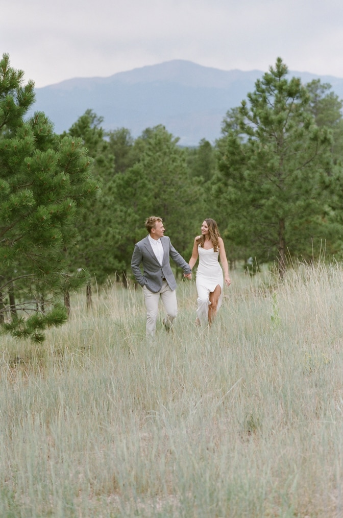 Bride and groom to be walking hand in hand during their Colorado engagement session with Colorado wedding photographer Tamara Gruner