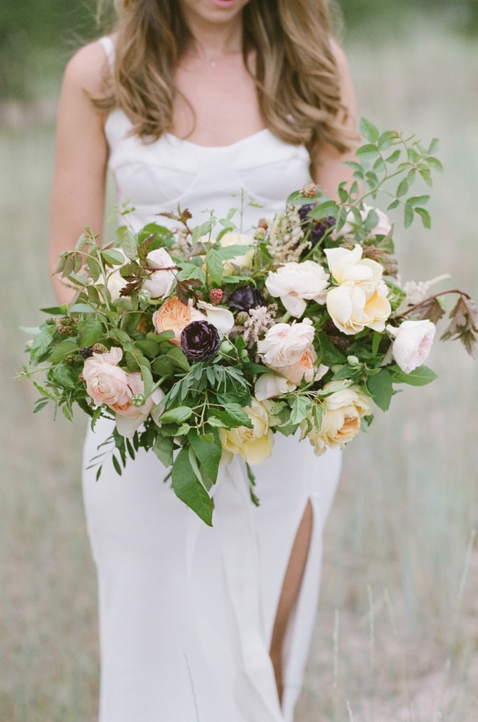 Closeup of a blush organic bouquet by Layers of Lovely during Colorado engagement