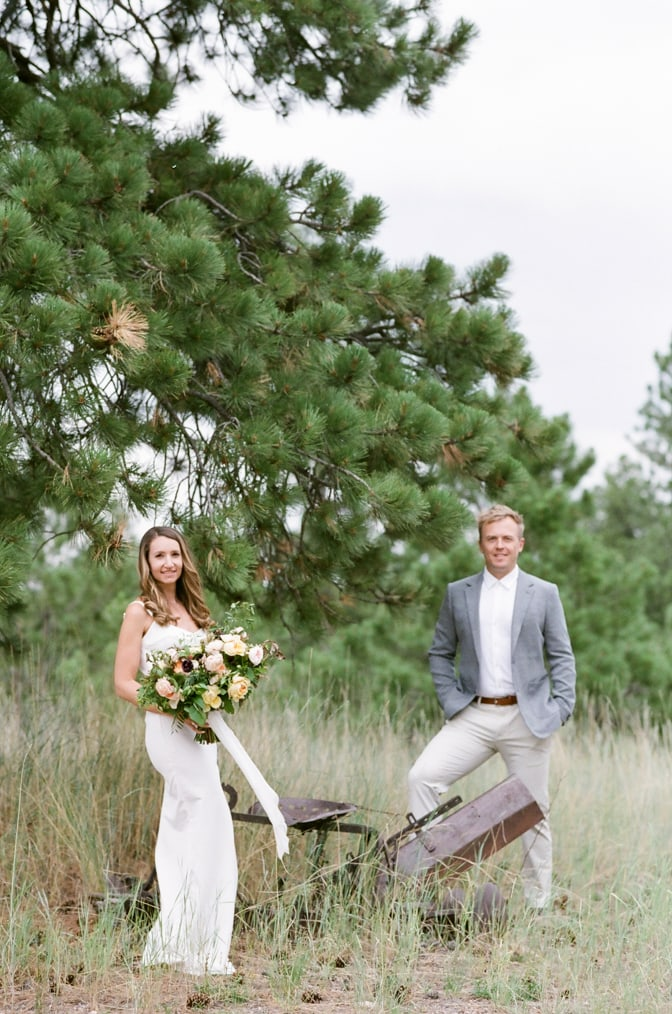 Bride and groom to be standing next to each other and facing Colorado wedding photographer Tamara Gruner