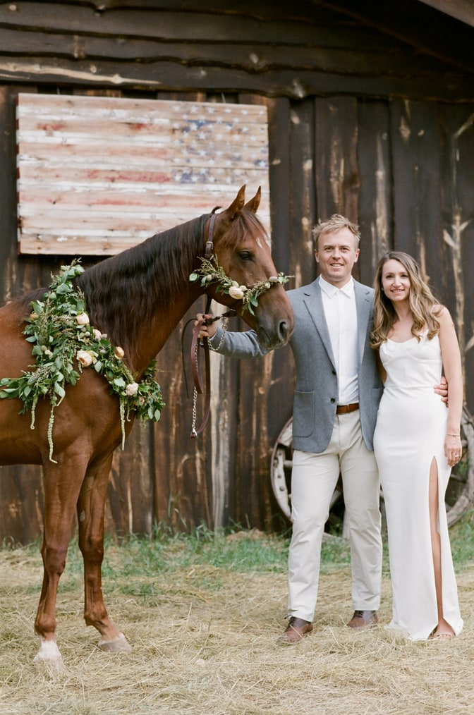 Bride and groom with their horse during their Colorado Wedding