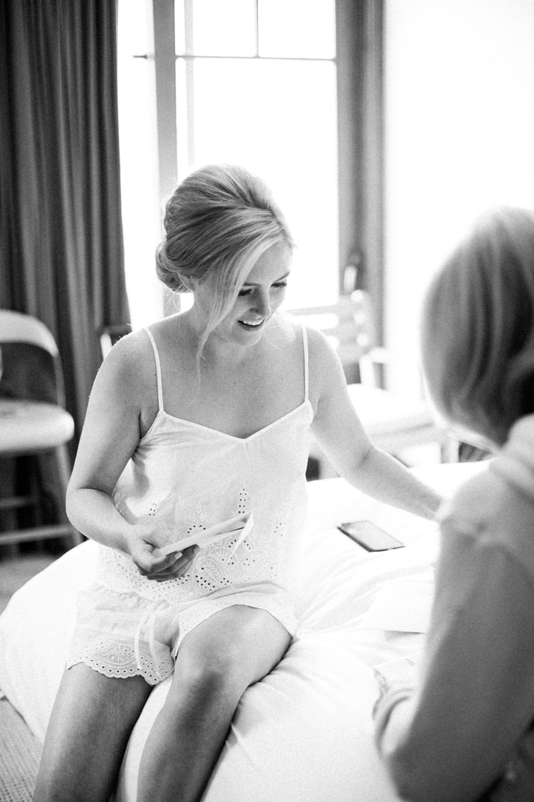 Bride opening a present from her mom at Four Seasons Vail