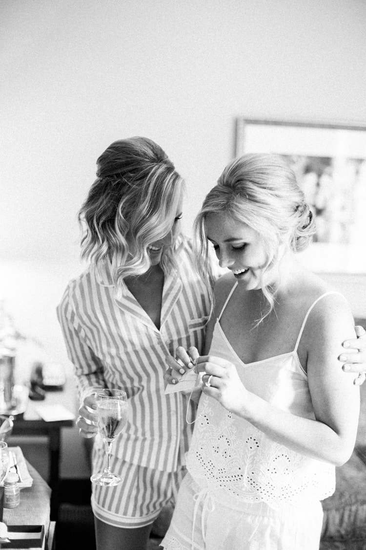 Bride embracing her maid of honor during getting ready session