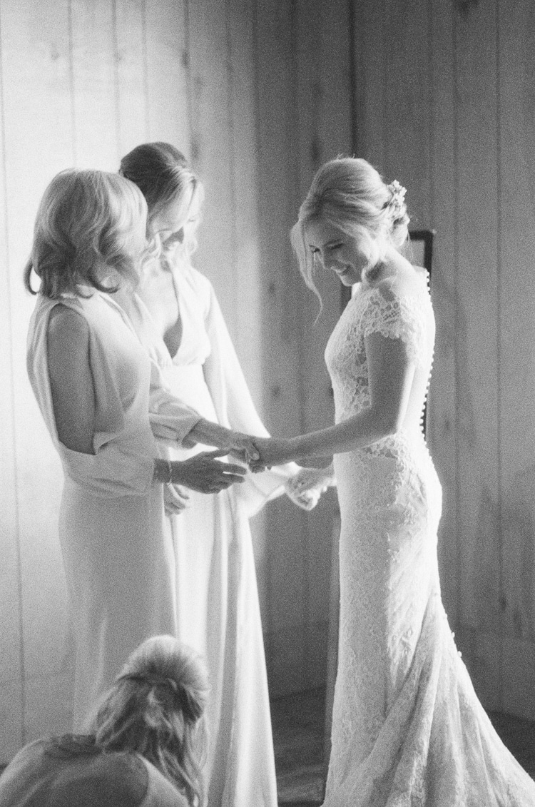 Bridal party dressing up the bride at Eaton Ranch