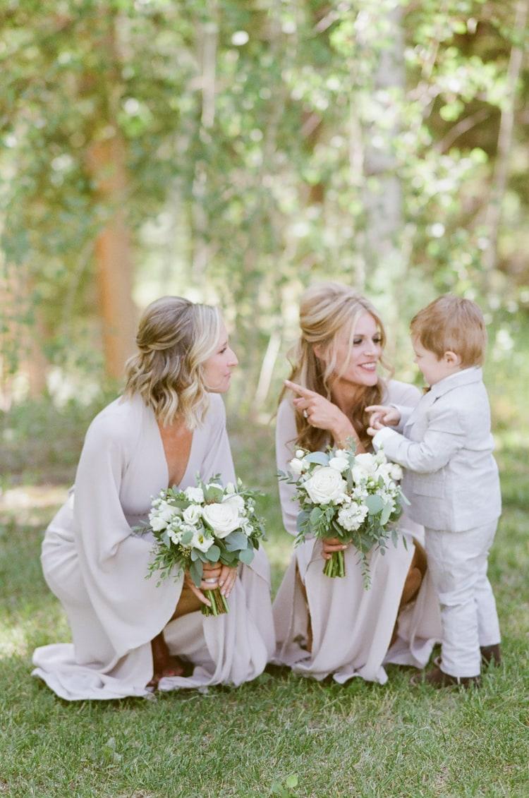 Bridesmaids talking to ring bearer at Eaton Ranch wedding