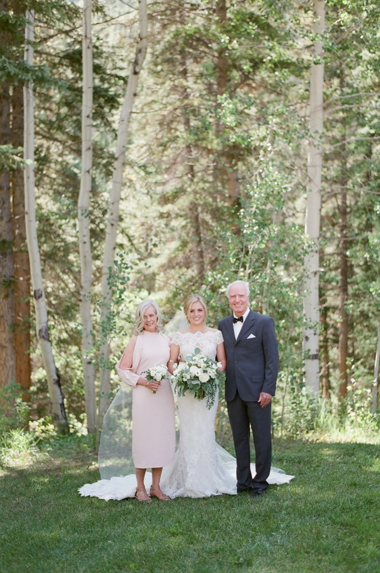 Bride and her parents taking family portraits at Eaton Ranch wedding