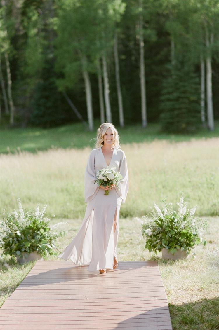 Bridesmaid walking down the aisle at Eaton Ranch wedding
