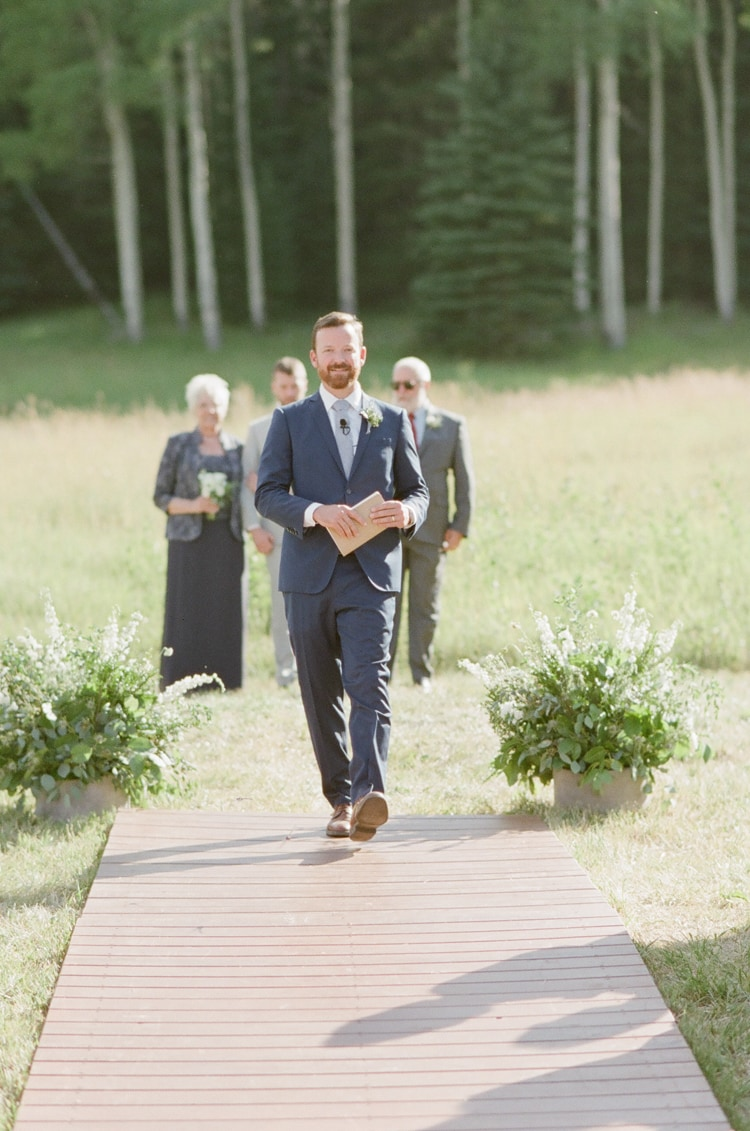Officiant walking down the aisle during Eaton Ranch wedding