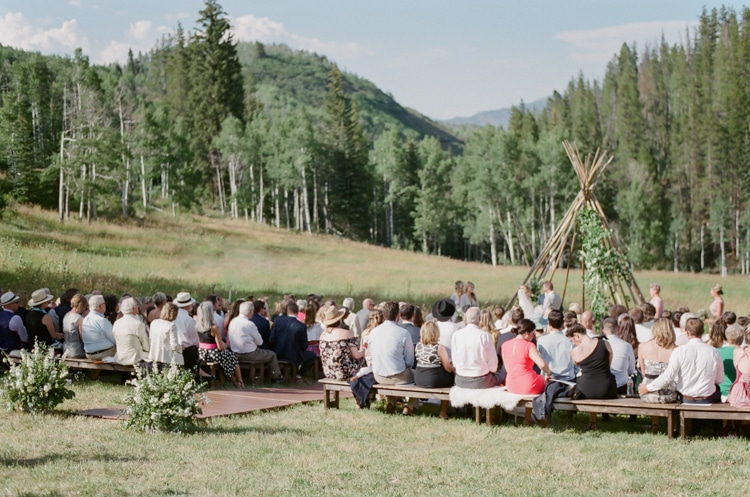 Wedding guests sitting at wedding ceremony during Eaton Ranch wedding