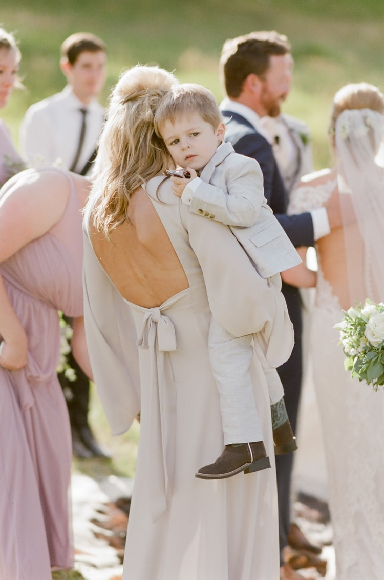 Maid of Honor carrying ring bearer at Eaton Ranch
