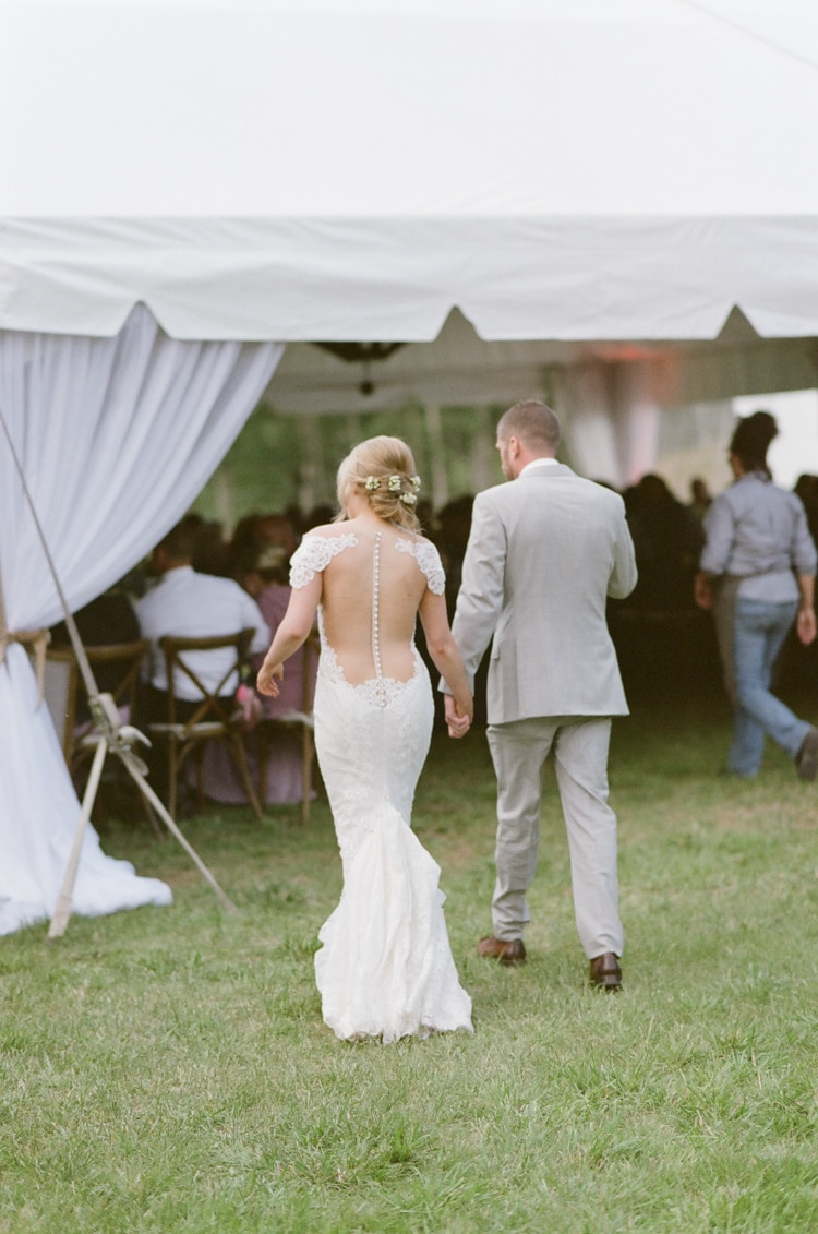Bride and groom walking into their tent wedding reception at Eaton Ranch