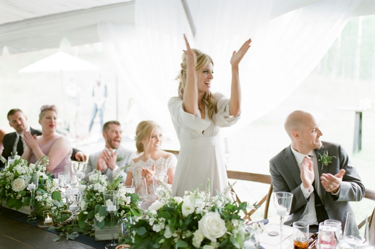 Maid of honor cheering during speeches at Vail wedding
