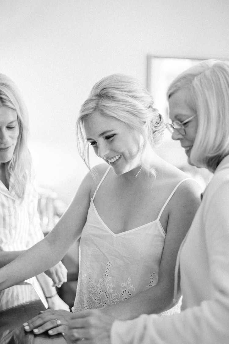 Bride with mother of bride reading a letter during getting ready session