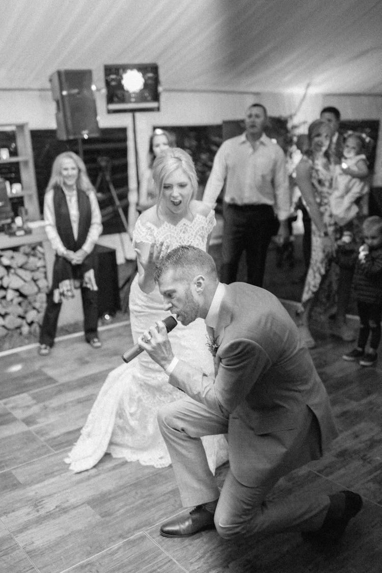 Groom singing for his bride during wedding reception in Colorado