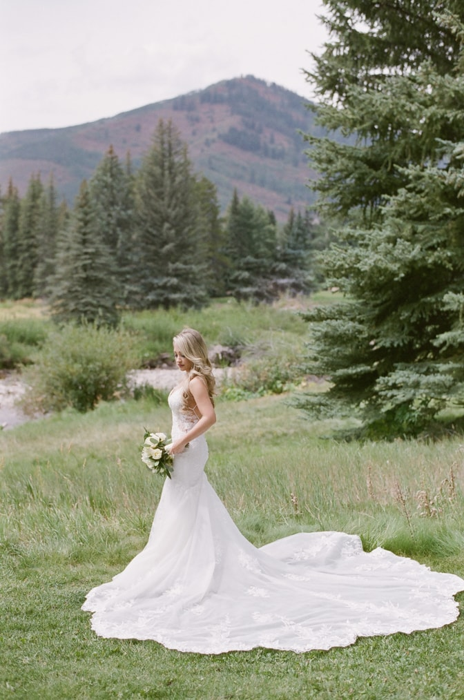 Bride posing in front of Vail mountain for Vail wedding photographer Tamara Gruner