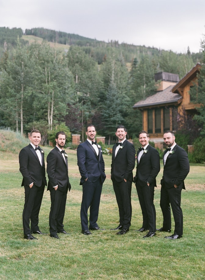 Groom standing with his groomsmen at Larkspur events and dining