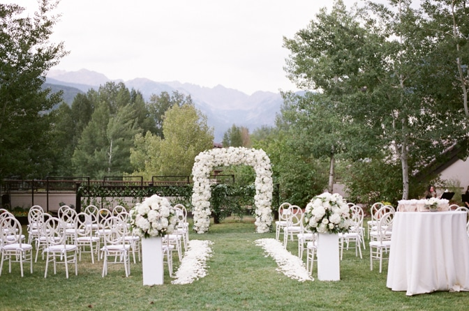 Ceremony arch with chairs at Larkspur events and dining Vail wedding