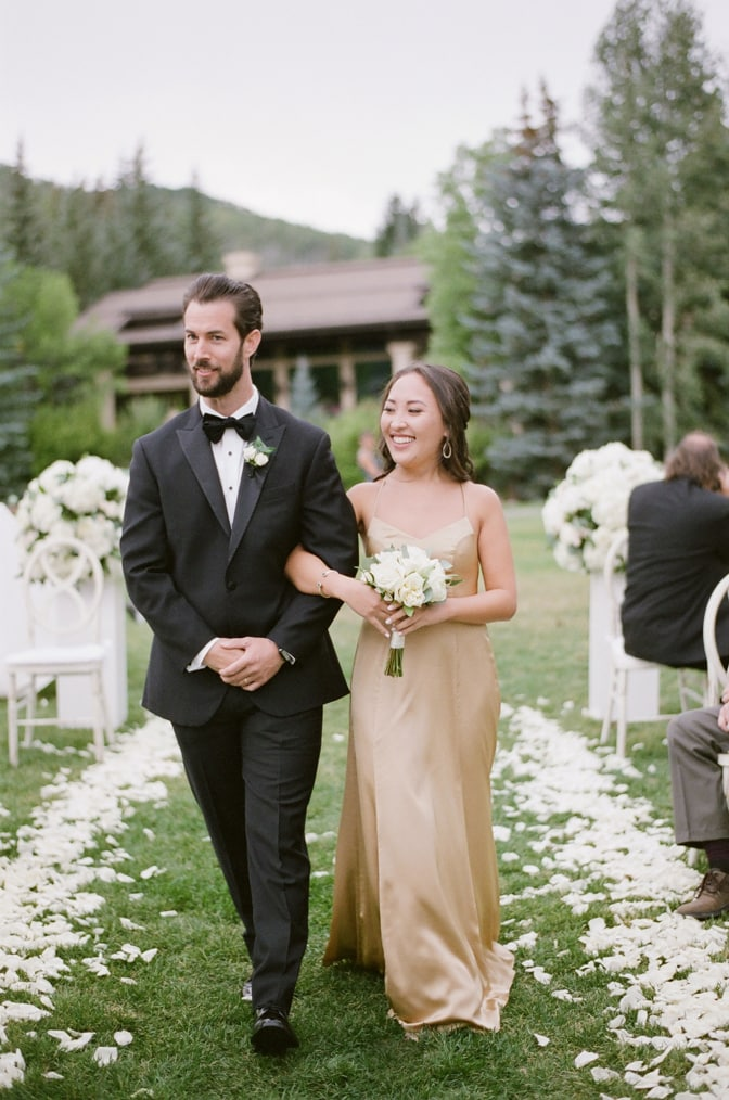 Bridal party walking down the aisle at Larkspur events and dining in Vail