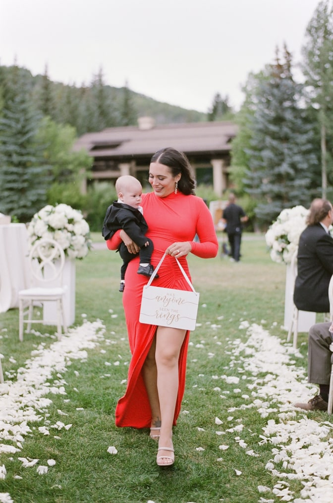 Ringbearer being carried at Larkspur events and dining Vail wedding