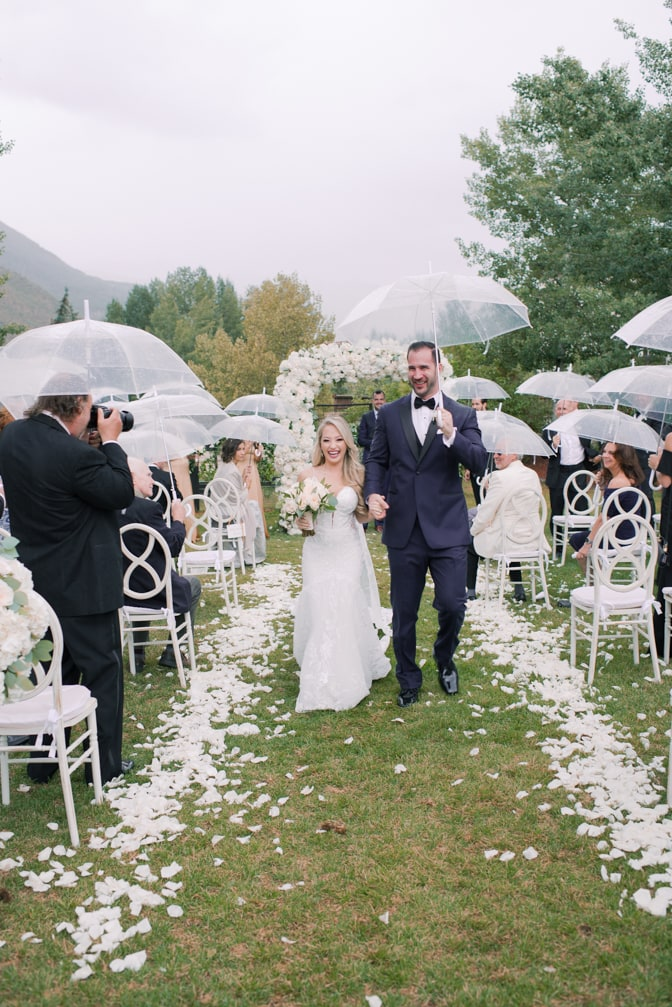 Bride and groom walking down the aisle together after getting married at Larkspur events and dining in Vail