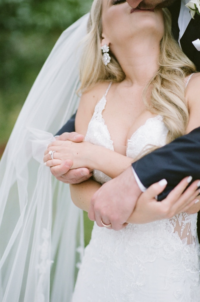 Closeup of bride and groom's hands with rings