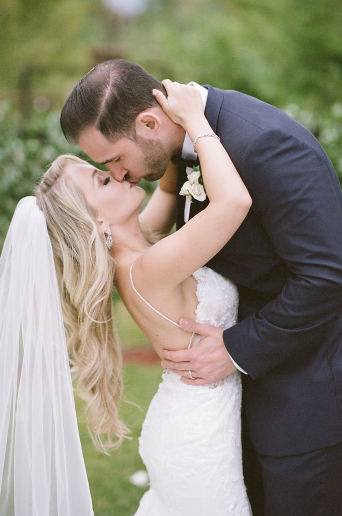 Bride kissing her groom during their Vail wedding at Larkspur events and dining