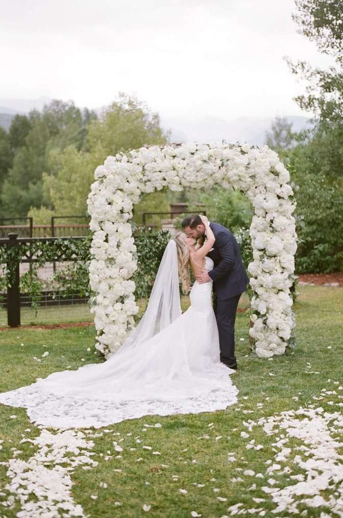 Bride and groom kissing at Larkspur events and dining in Vail